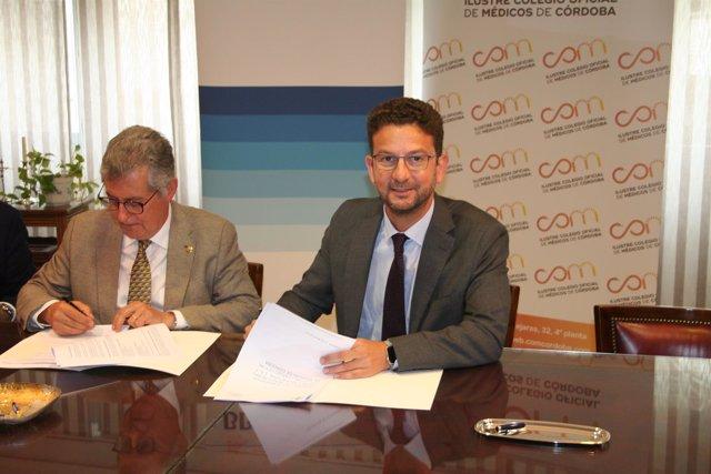 Galán y García Cáceres durante la firma