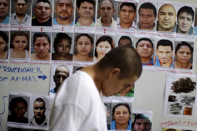 Suspected members of the MS-13 gang are presented to the media in San Salvador J