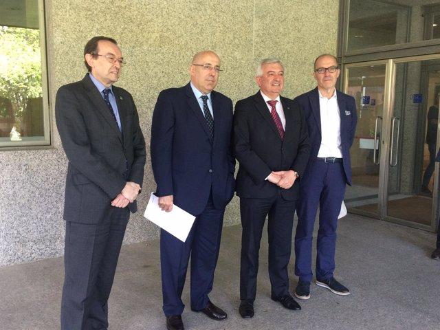 Martí Parellada junto al rector de la USC y Senén Barro