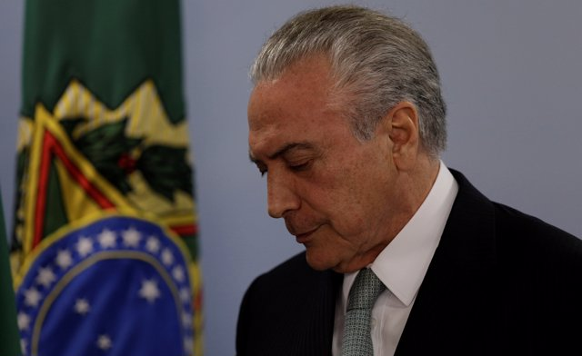 Brazil's President Michel Temer reacts as he speaks at the Planalto Palace in Br