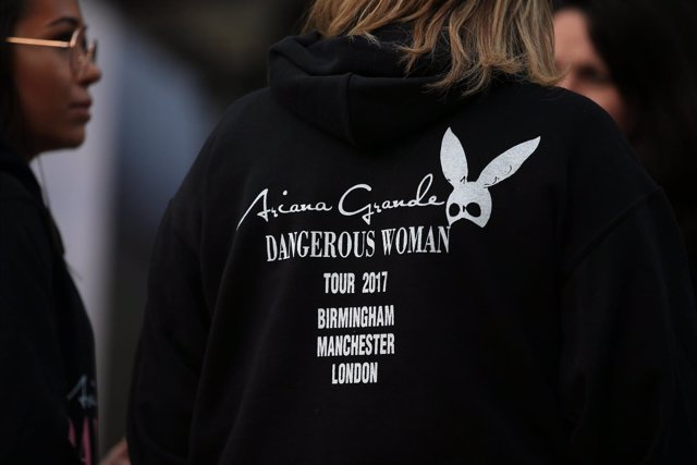 A fan wears an Ariana Grande hoodie near the Manchester Arena where a suspected