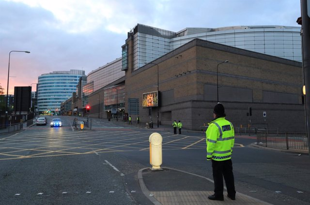 A police officer on the streets the morning after a suspected terrorist attack a