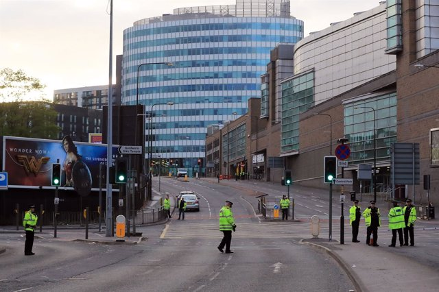 Police patrol outside the Manchester Arena the morning after a suspected terrori
