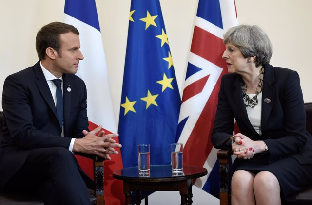 Emmanuel Macron y Theresa May