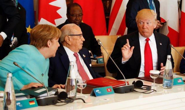 Donald Trump y Angela Merkel discuten en Taormina