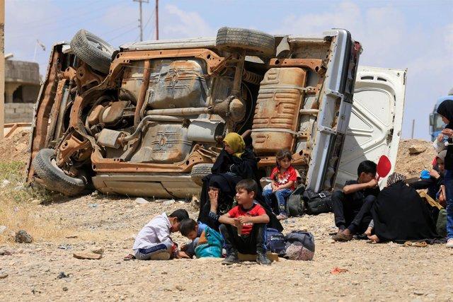 Iraquíes de Mosul desplazados