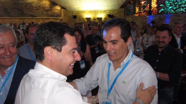 José Antonio Nieto y Juanma Moreno con Javier Arenas y Toni Martín al fondo