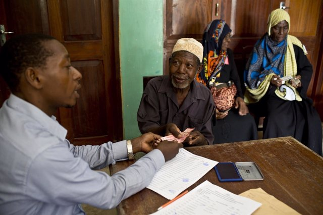 Elderly people who are the first ones to receive a pension from the state pose f
