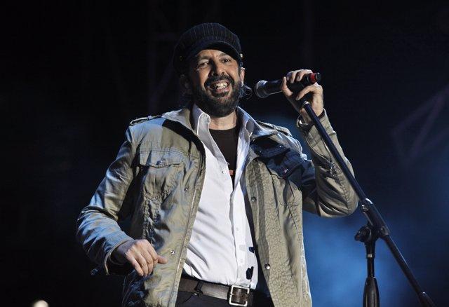 Singer Juan Luis Guerra performs during a fund-raising concert in Santo Domingo