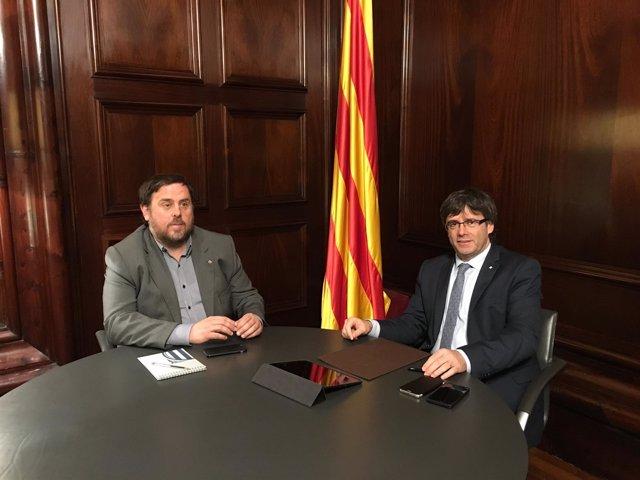 Oriol Junqueras, y Carles Puigdemont