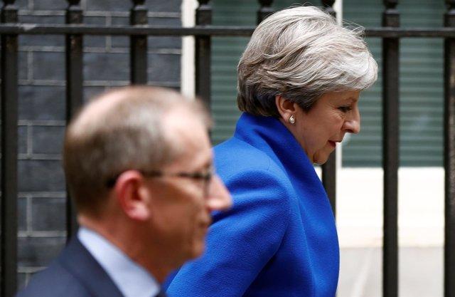 Theresa May y su marido