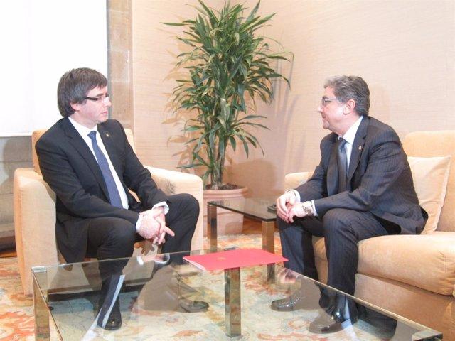 El presidente Carles Puigdemont y el delegado del Gobierno Enric Millo
