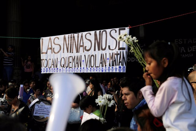 People take part in a protest to demand justice for the victims of a fire at the