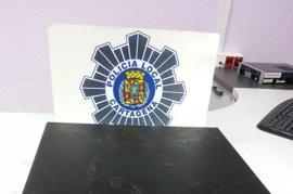 Detenidos dos individuos cuando se llevaban la caja registradora de un bar de Cartagena
