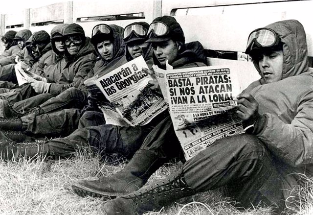 Argentinian army soldiers read newspapers in Port Stanley, during the Falkland W