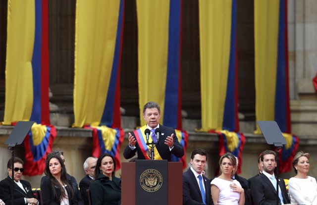 Colombia's President Juan Manuel Santos speaks after being decorated with the Co