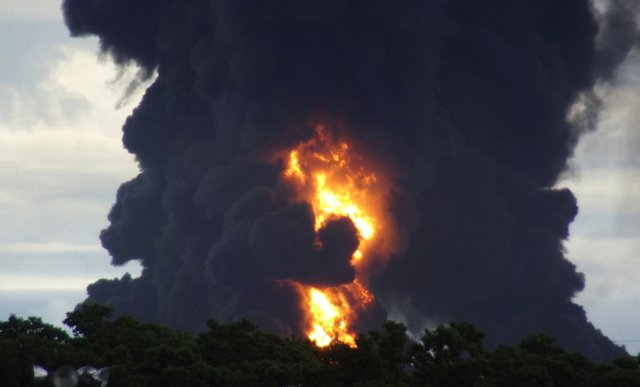 A general view shows smoke rising from a fire at Mexico's state-owned oil firm P