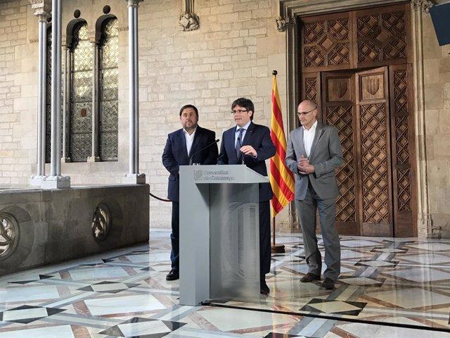 El pte. C.Puigdemont y los consellers O.Junqueras y R.Romeva