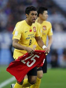 Paulinho of China's Guangzhou Evergrande celebrates with teammates after he scor