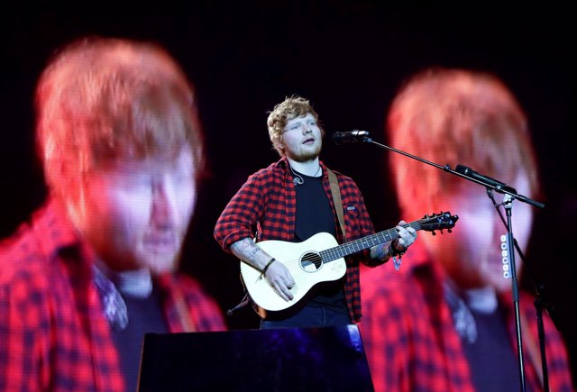 Ed Sheeran performing on the Pyramid stage at Glastonbury Festival, at Worthy Fa