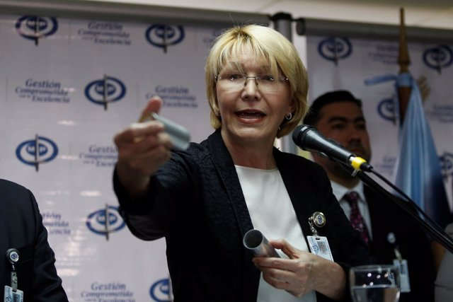 Venezuela's chief prosecutor Luisa Ortega Diaz displays a tear gas canister as s