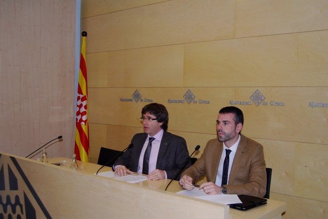 Carles Puigdemont, y Santi Vila