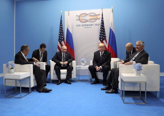 Donald Trump, Rex Tillerson, Vladimir Putin y Sergei Lavrov