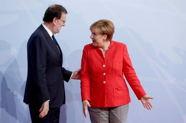 Mariano Rajoy con Angela Merkel