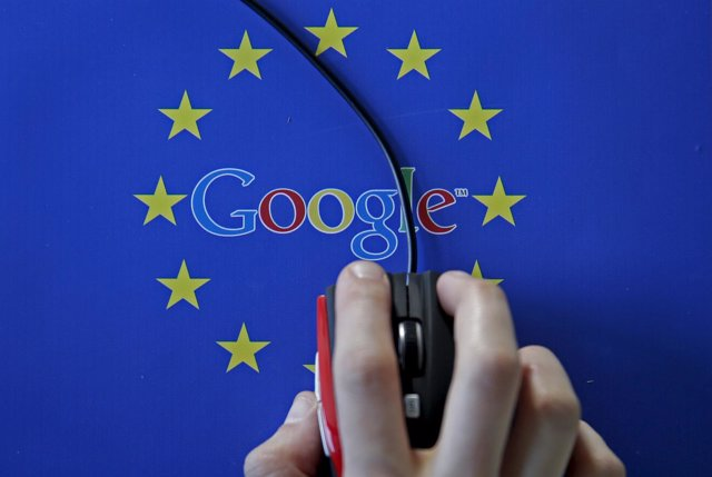 A woman hovers a mouse over the Google and European Union logos in Sarajevo, in