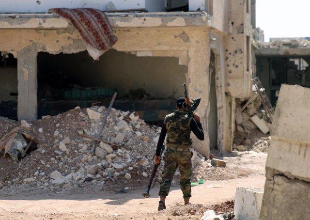 Combatiente de la oposición siria en Deraa
