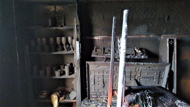 Casa afectada por el fuego