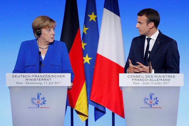 Merkel y Macron en la reunión anual en París