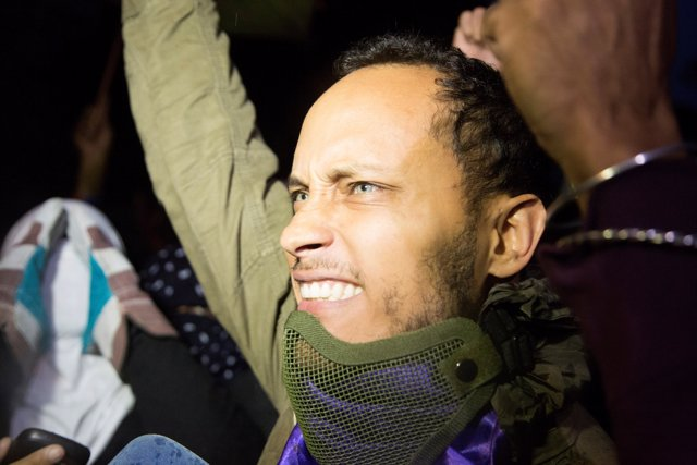 Police official Oscar Perez attends a vigil in homage to victims of violence at