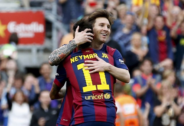 Barcelona's Lionel Messi celebrates his second goal against Deportivo de la Coru