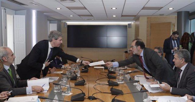 Presidente del TSJM con Garrido