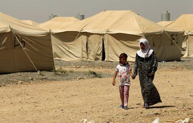 Una mujer acusada de ser familiar de un miliciano de Estado Islámico