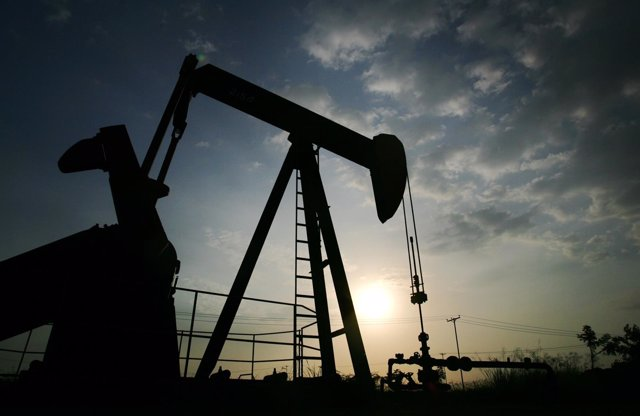A pump jack is seen during sunset at Lagunillas field in the eastern coast of La