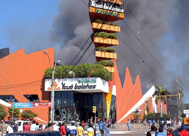 Smoke rises from a supermarket on the outskirts of Paraguay's capital Asuncion,