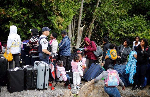 Solicitantes de asilo en la frontera entre EEUU y Canadá.