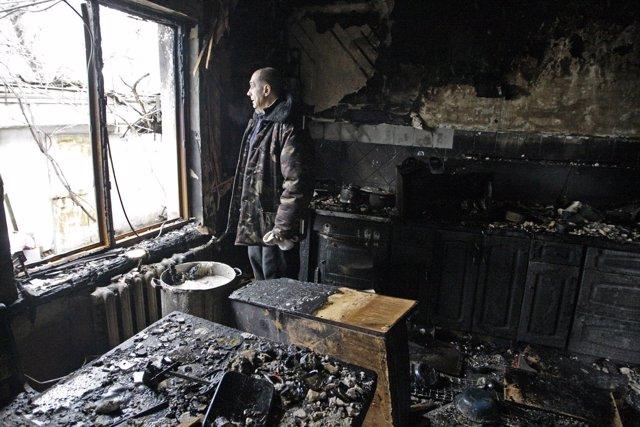 Vivienda dañada por los combates en Donetsk