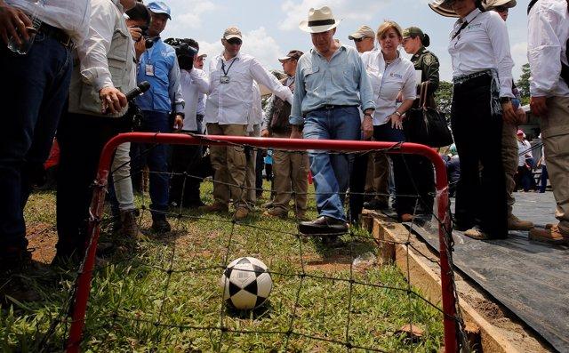 Colombia's President Juan Manuel Santos kicks a soccer ball into a goal during a