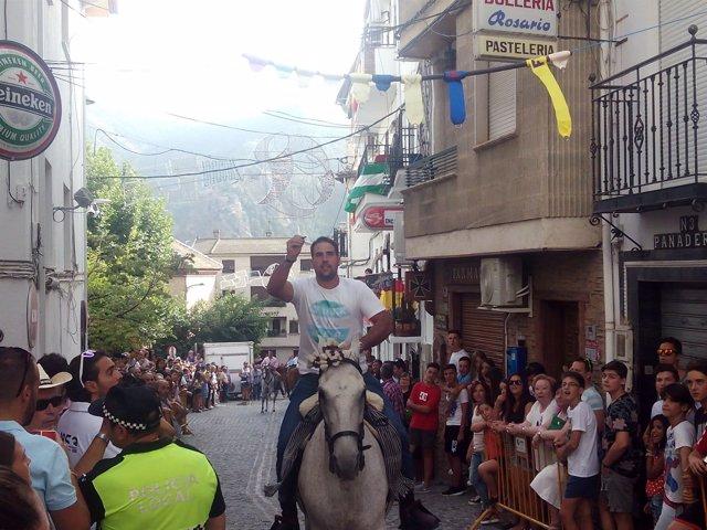 Carrera de cintas a caballo en Güéjar Sierra