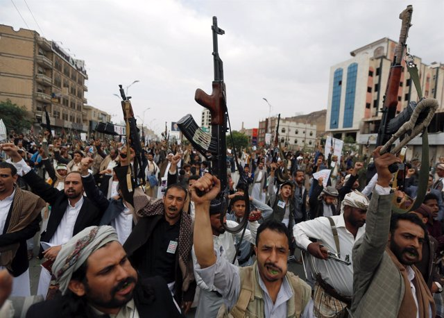 Followers of the Houthi movement shout slogans