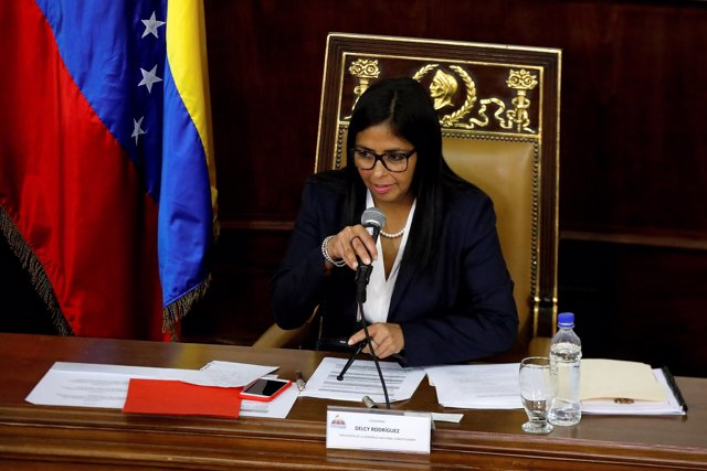FILE PHOTO: National Constituent Assembly President Delcy Rodriguez attends to o