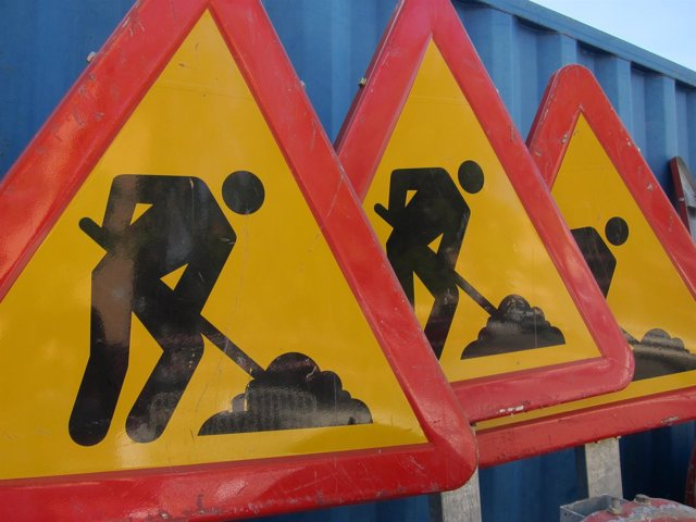 Señales de obras, asfaltado