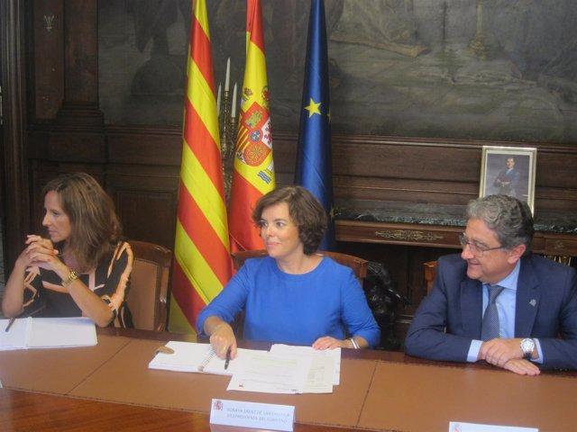 Soraya Sáenz de Santamaría y Enric Millo