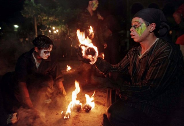 Salvadorean youths prepare fire balls late August 31 in the town of Nejapa, wher