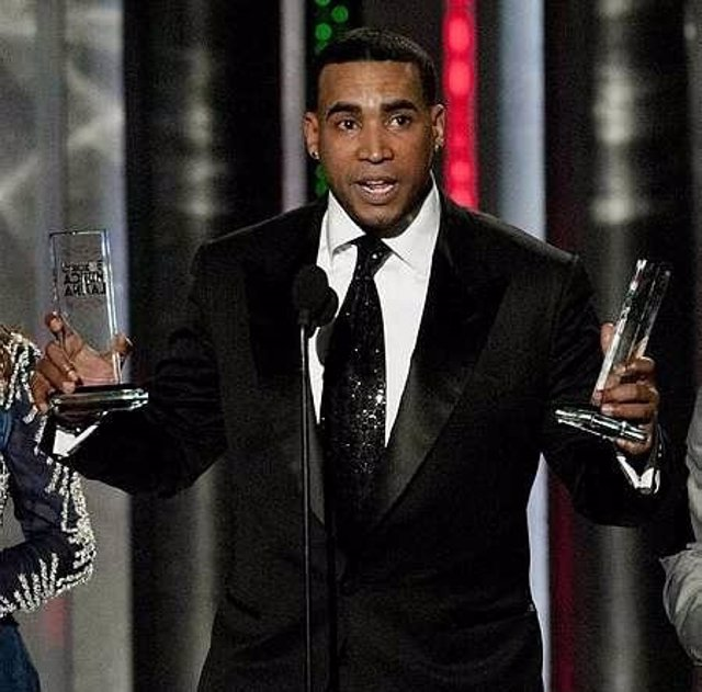 Image #: 17720653    Latin singer Don Omar holds two of his awards at the 2012 B