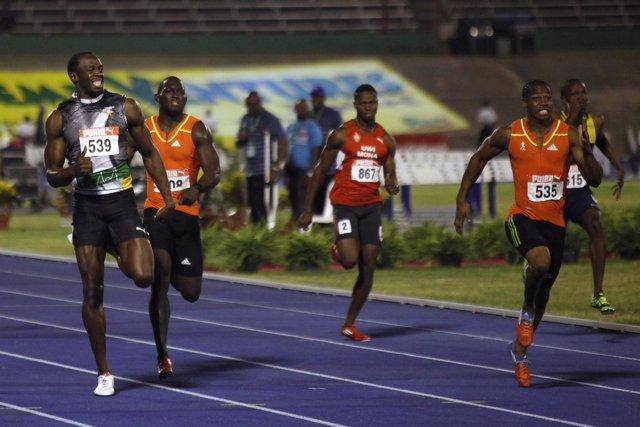 Atletas Yohan Blake y Usain Bolt