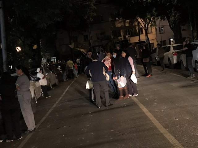 People gather on a street after an earthquake hit Mexico City, Mexico late Septe
